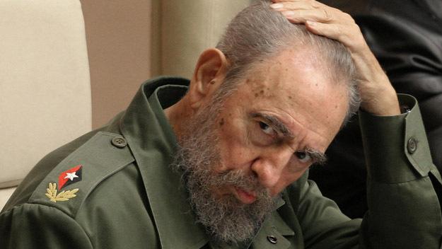 Cuban President Fidel Castro touches his